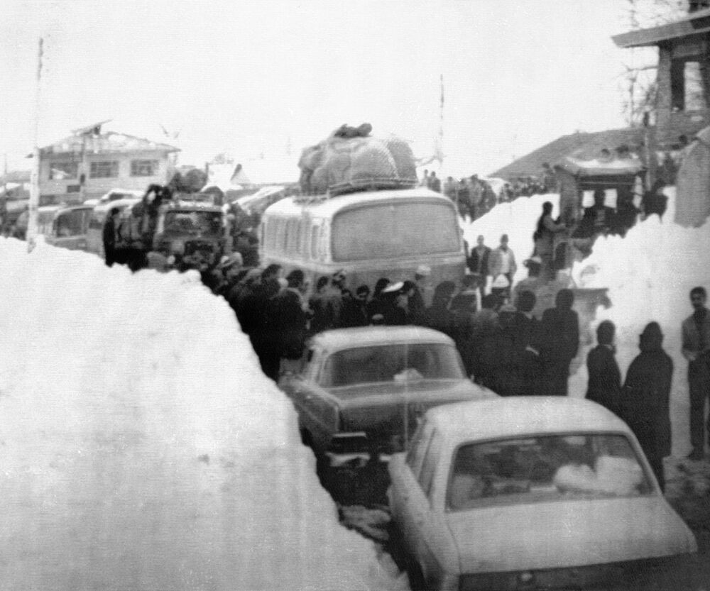 Cars, buses, and people clog this street in Teheran, Iran in 1972, after nearly eight feet of snow fell on the city.
