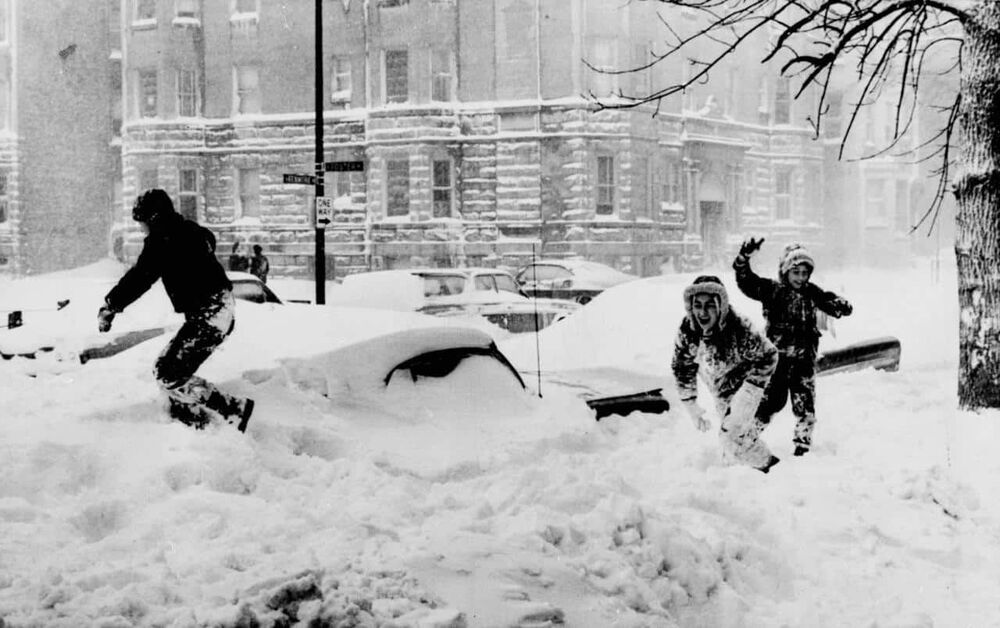 Children playing in the snow after the 1967 blizzard in Chicago.