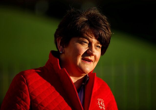 Northern Ireland's First Minister Arlene Foster answers questions during a television interview outside the Stormont Parliament building in Belfast, Northern Ireland, 30 December 2020.