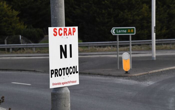 A sign is seen with a message against the Brexit border checks in relation to the Northern Ireland protocol at the harbour in Larne, Northern Ireland February 12, 2021