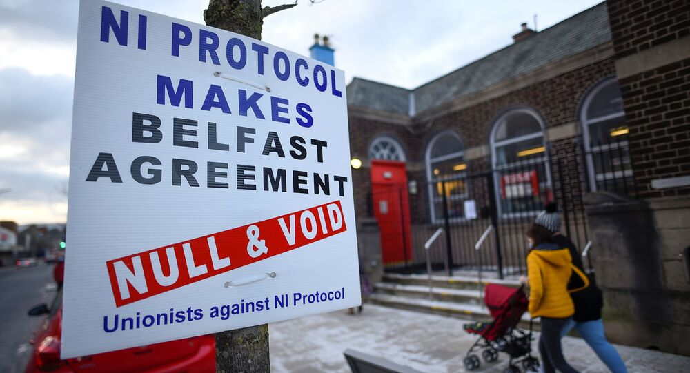 A sign is seen with a message against the Brexit border checks in relation to the Northern Ireland protocol in Larne, Northern Ireland February 12, 2021