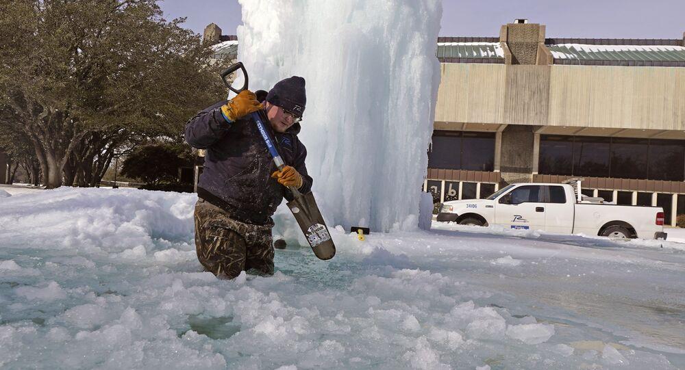 City of Richardson worker Kaleb Love breaks ice on a frozen fountain Tuesday, Feb. 16, 2021, in Richardson, Texas