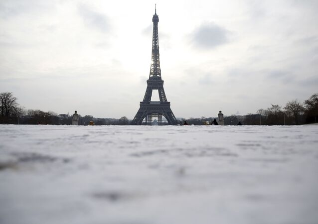 Snow covers the Trocadero gardens with the Eiffel Tower in the background, in Paris, 10 February 2021