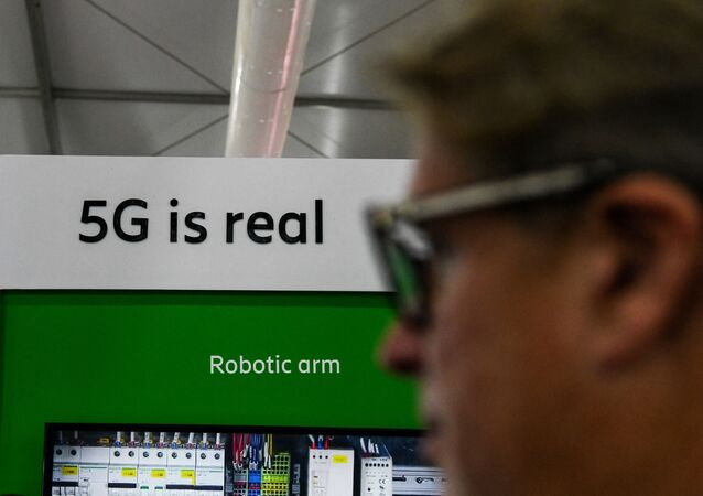 A visitor walks past a 5G display at the India Mobile Congress 2018 in New Delhi on October 25, 2018