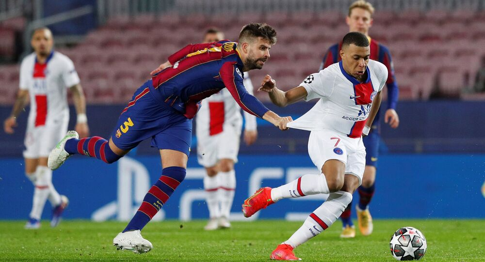 Paris St Germain's Kylian Mbappe in action with Barcelona's Gerard Pique in Barcelona, Spain on16 February 2021.