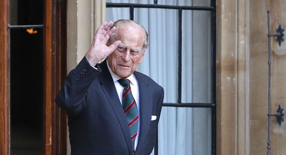 Britain's Prince Philip (R), Duke of Edinburgh arrives for the transfer of the Colonel-in-Chief of The Rifles ceremony at Windsor castle in Windsor on July 22, 2020