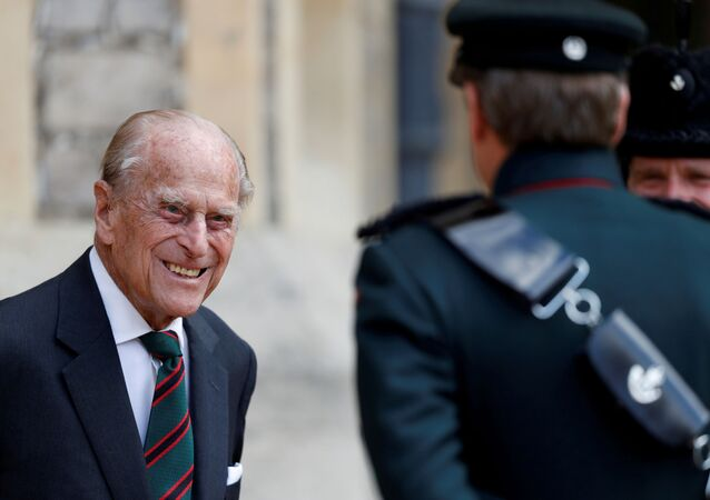 Britain's Prince Philip speaks to Assistant Colonel Commandant, Major General Tom Copinger-Symes during the transfer of the Colonel-in-Chief of the Rifles at Windsor Castle in Britain July 22, 2020