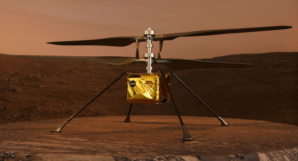 A full scale model of the experimental Ingenuity Mars Helicopter, which will be carried under the Mars 2020 Perseverance rover, is displayed at NASA's Jet Propulsion Laboratory (JPL) on February 16, 2021 in Pasadena, California.