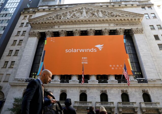 SolarWinds Corp. banner hangs at the New York Stock Exchange (NYSE) on the IPO day of the company in New York, U.S., October 19, 2018.