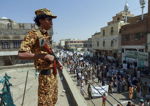 A fighter loyal to Yemen's Huthi rebels stands guard during a rally commemorating the death of Shiite Imam Zaid bin Ali in the capital Sanaa, on September 14, 2020.