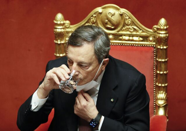 Italy's Prime Minister Mario Draghi drinks water during a debate at the Senate on February 17, 2021 in Rome, before submitting his government to a vote of confidence.