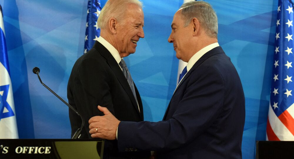 In this file photo taken on March 09, 2016, US Vice President Joe Biden and Israeli Prime Minister Benjamin Netanyahu shake hands while giving joint statements at the prime minister's office in Jerusalem.