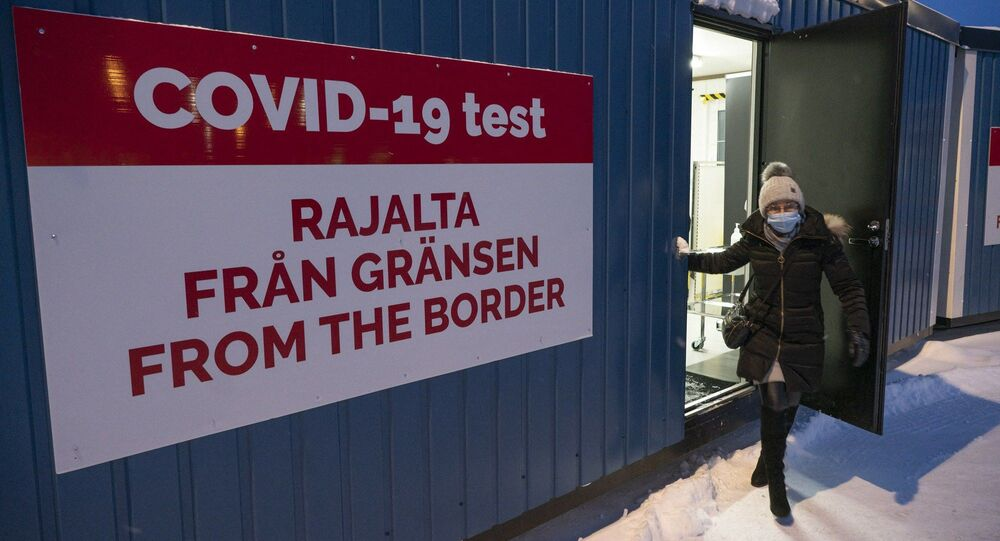 Eija Korolainen-Koivisto leaves after getting her voluntary Covid-19 test at the border at the border between Finland and Sweden in Tornio, Northern Finland on January 27, 2021.