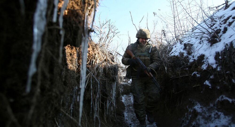 An Ukrainian serviceman stands in position on the front line with the Self-defense fighters of the Donetsk People's Republic on February 16, 2021