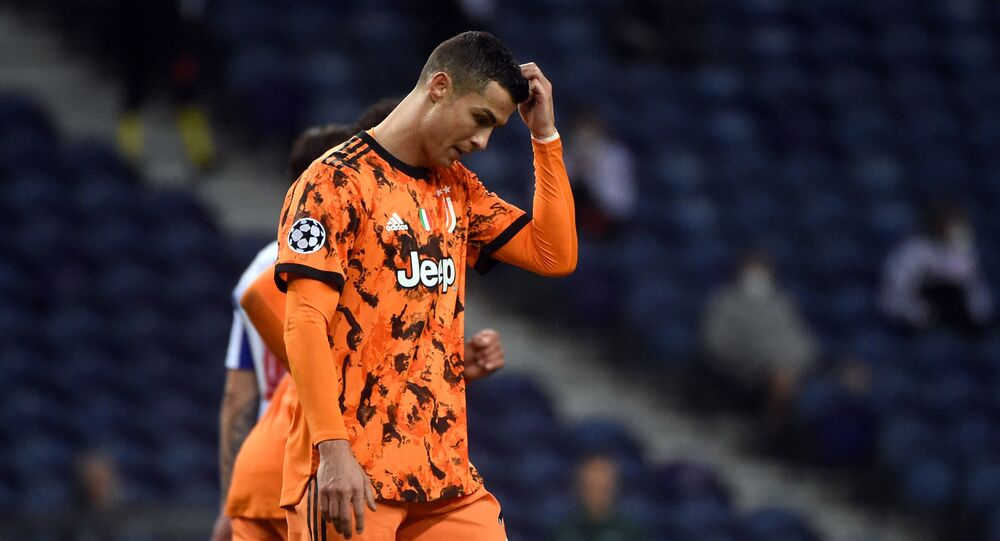 Juventus' Portuguese forward Cristiano Ronaldo gestures during the UEFA Champions League round of 16 first leg football match between Porto and Juventus at the Dragao stadium in Porto on February 17, 2021