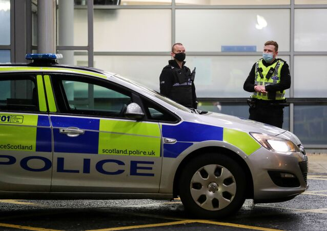 Police officers stand guard outside Crosshouse Hospital as it is put under lockdown as police deal with what they say are three potentially linked serious incidents in Kilmarnock, Scotland, 5 February 2021