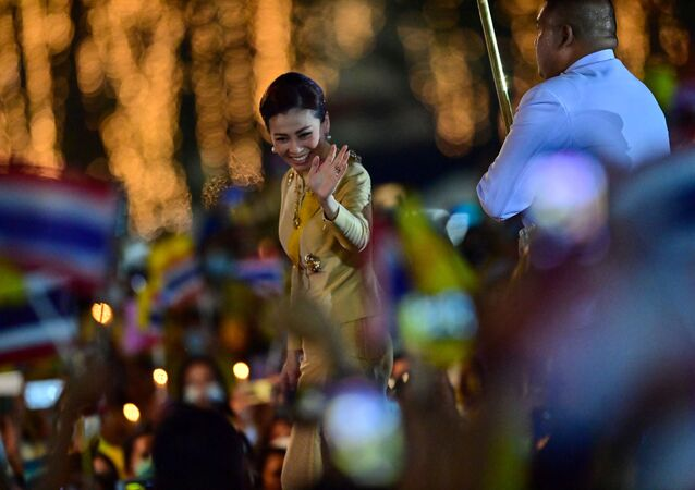 Thailand's Queen Suthida waves to royalist supporters during a ceremony to commemorate the birthday of the late Thai king Bhumibol Adulyadej at Sanam Luang in Bangkok on 5 December 2020