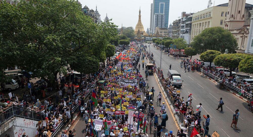 Demonstrators protest against the military coup in Yangon, Myanmar, February 18, 2021
