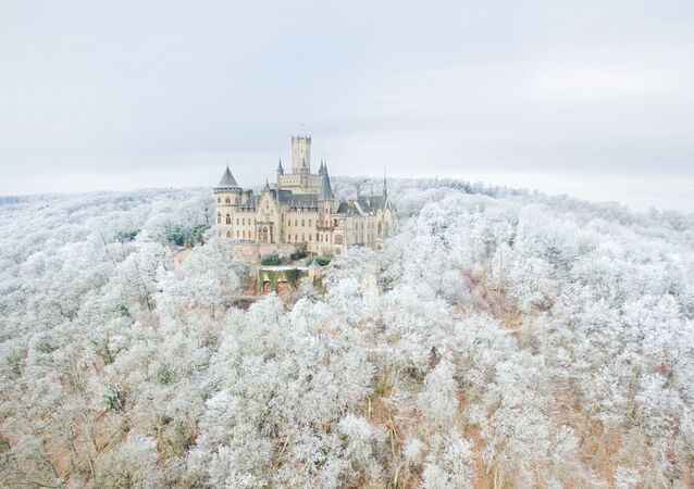 Aerial view taken on January 18, 2017 with a drone shows the Marienburg Castle near Pattensen, northern Germany, standing amidst a snow-covered forest.