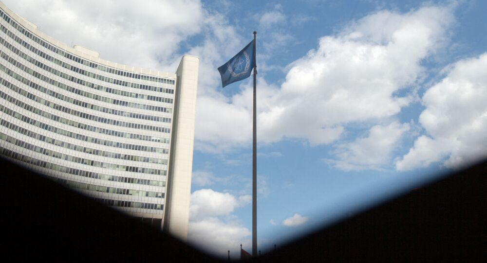 The flag of the International Atomic Energy Agency (IAEA) flutters in front of the IAEA building in Vienna on July 10, 2019. - The UN's nuclear watchdog will hold a special meeting on Iran's nuclear programme, after Tehran breached one of the limits set in a 2015 deal with world powers.