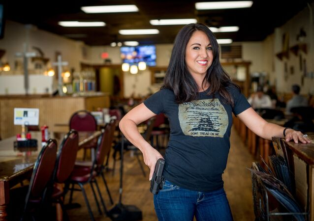 In this file photo owner Lauren Boebert poses for a portrait at Shooters Grill in Rifle, Colorado on April 24, 2018. - A Republican member of the US Congress raised eyebrows on February 18, 2021 when she appeared at a Zoom committee meeting with an arsenal of guns strategically displayed in her background.