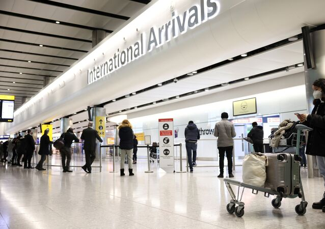 Travellers stand at Terminal 2 of Heathrow Airport, amid the coronavirus disease (COVID-19) outbreak in London, Britain February 14, 2021
