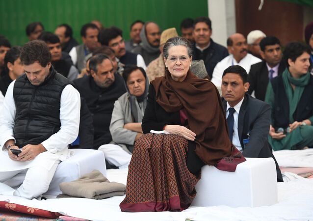 Congress president Sonia Gandhi (R) and former party president Rahul Gandhi attend a sit-in protest for unity in New Delhi on 23 December 2019, amid widespread protests against India's new citizenship law.