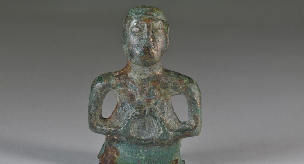 The tiny 1st century figure of a Celtic deity found by National Trust archaeologists shows remarkable detail, including a moustache and details of its hair style