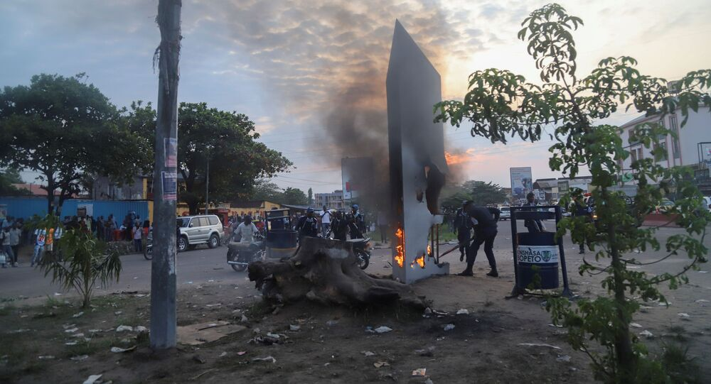 Residents set fire to mysterious monolith that appeared in Kinshasa, Democratic Republic of Congo February 17, 2021