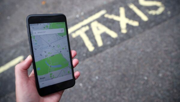 FILE PHOTO: The Uber application is seen on a mobile phone in London - Sputnik International