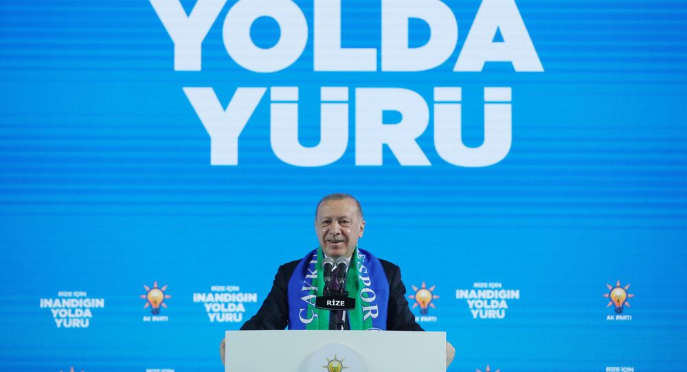 Turkish President Tayyip Erdogan addresses members of his ruling AK Party (AKP) during a meeting in Rize, Turkey, February 15, 2021.