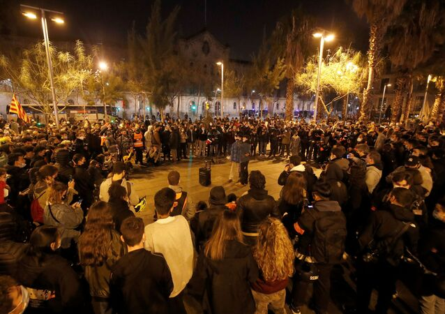People sing during a protest in support of Catalan rapper Pablo Hasel, after he was given a jail sentence on charges of glorifying terrorism and insulting royalty in his songs, in Barcelona, Spain, February 19, 2021.
