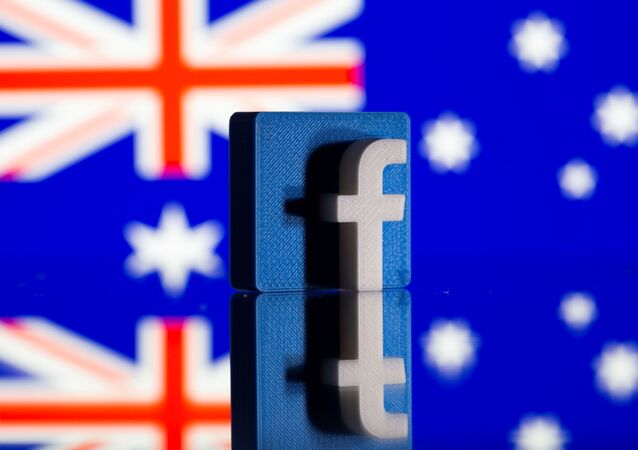 A 3D printed Facebook logo is seen in front of displayed Australia's flag in this illustration photo taken February 18, 2021