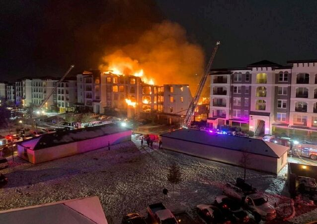 A general view of an apartment building engulfed in flames in San Antonio, Texas, U.S. February 18, 2021 in this picture obtained from social media