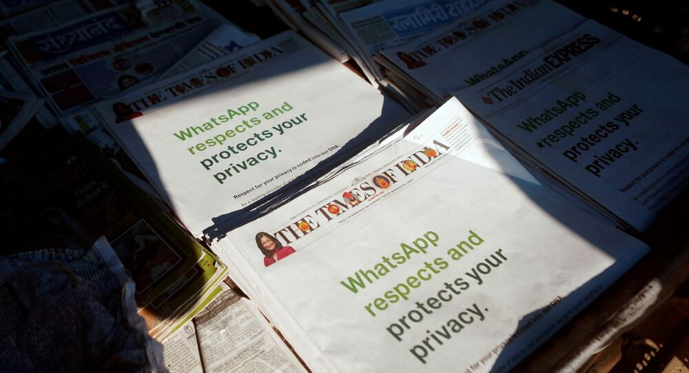 A WhatsApp advertisement is seen on the front pages of newspapers at a stall in Mumbai, India, January 13, 2021
