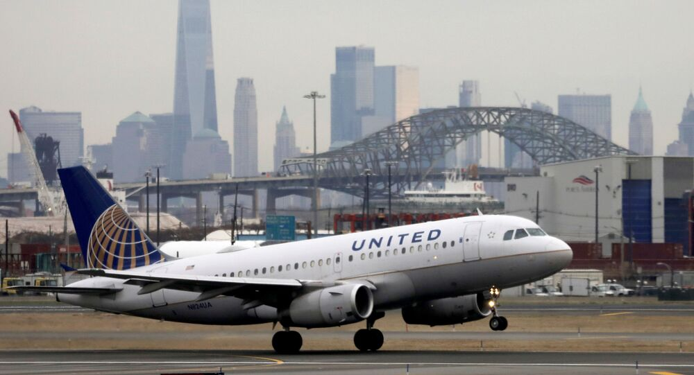A United Airlines passenger jet takes off with New York City as a backdrop, at Newark Liberty International Airport, New Jersey, U.S. December 6, 2019.