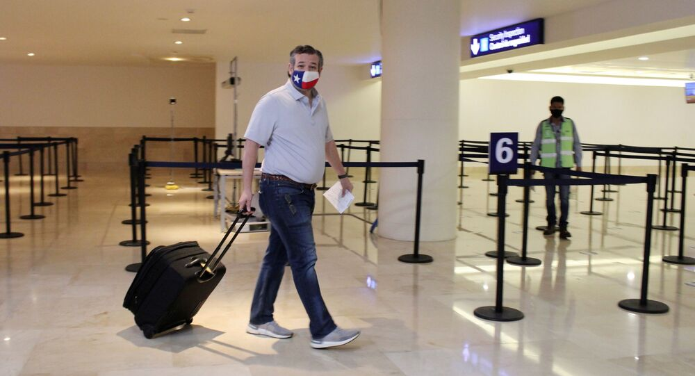 U.S. Senator Ted Cruz (R-TX) carries his luggage at the Cancun International Airport before boarding his plane back to the U.S., in Cancun, Mexico February 18, 2021.