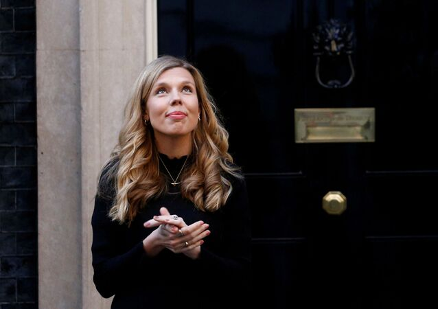 FILE PHOTO: Britain's Prime Minister Boris Johnson partner Carrie Symonds reacts outside 10 Downing Street during the Clap for our Carers campaign in support of the NHS, following the outbreak of the coronavirus disease (COVID-19), London, Britain, May 14, 2020.