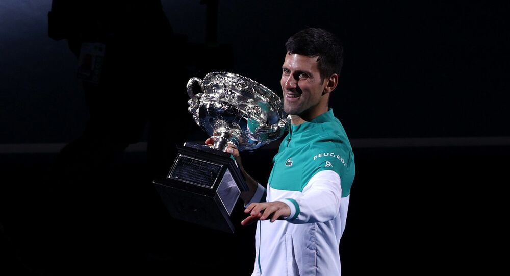 Australian Open - Men's Singles Final - Melbourne Park, Melbourne, Australia, February 21, 2021 Serbia's Novak Djokovic celebrates with the trophy after winning his final match against Russia's Daniil Medvedev