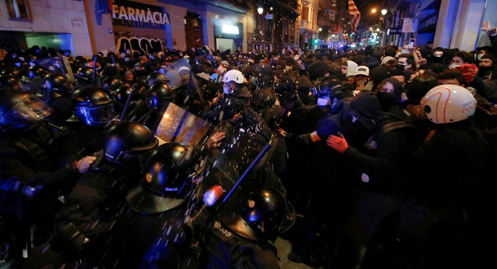 Demonstrators clash with police as supporters of arrested Catalan rapper Pablo Hasel protest in Barcelona, Spain, February 20, 2021.