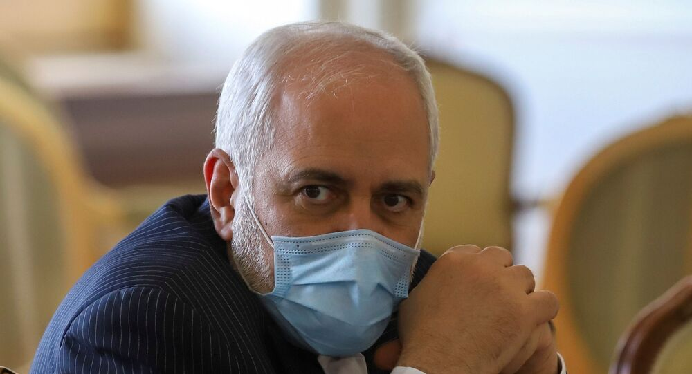 Iran's Foreign Minister Mohammad Javad Zarif looks on during a meeting with International Atomic Energy Agency (IAEA) Director General Rafael Grossi in Tehran, Iran February 21, 2021.