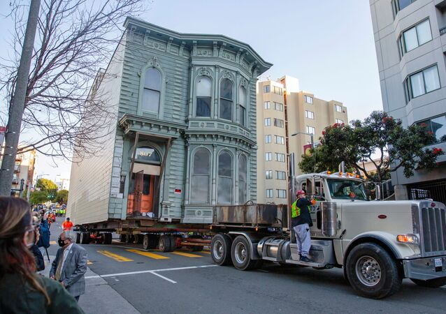 The 139-year-old Victorian house known as the Englander House is hoisted on a flat bed and pulled down Franklin Street towards its new location six blocks away, as the original site is to be used to build a 48-unit, eight-story apartment building, in San Francisco, California, U.S. February 21, 2021.