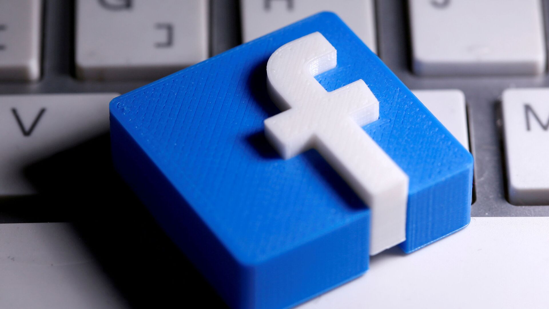 A 3D-printed Facebook logo is seen placed on a keyboard in this illustration taken March 25, 2020.  - Sputnik International, 1920, 14.09.2021