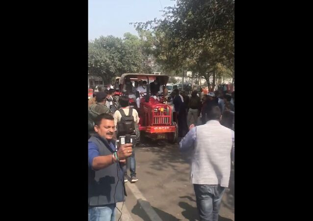Bihar opposition leader Tejashwi Yadav rides a tractor to the state legislative assembly on Monday, 22 February