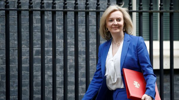 Britain's Secretary of State of International Trade and Minister for Women and Equalities Liz Truss is seen outside Downing Street, in London, Britain March 17, 2020. - Sputnik International