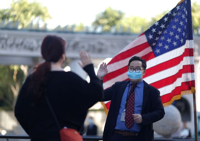 A USCIS employee swears in an immigrant in a socially-distanced outdoor naturalization ceremony to become a new U.S. citizen, as the coronavirus disease (COVID-19) outbreak continues, in Los Angeles, California, U.S., February 5, 2021.