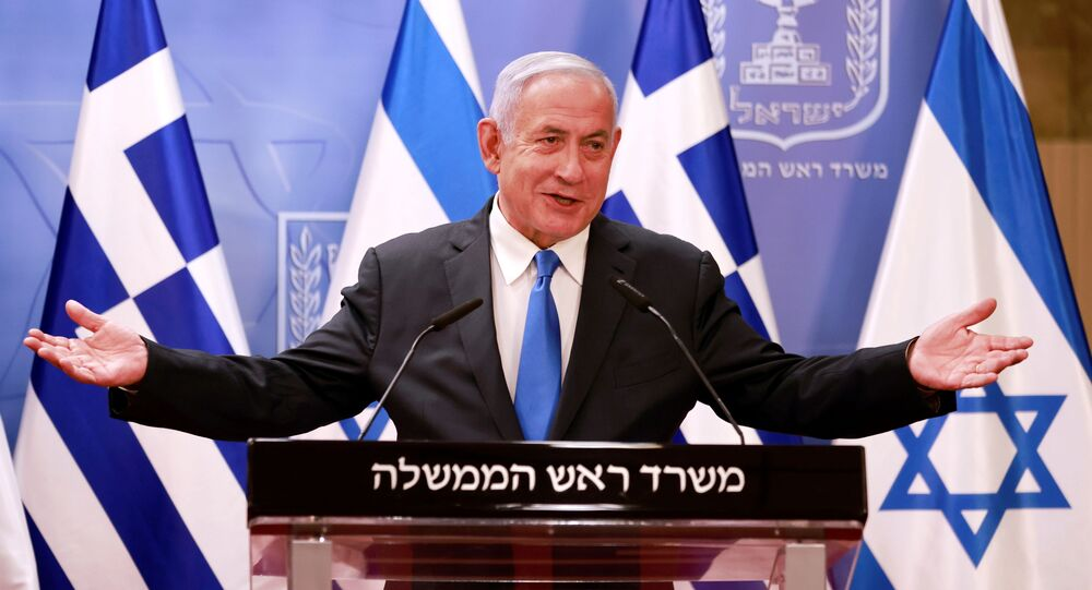 Israeli Prime Minister Benjamin Netanyahu speaks at a news conference next to Greek Prime Minister Kyriakos Mitsotakis (not pictured) after their meeting in the PM's office in Jerusalem February 8, 2021