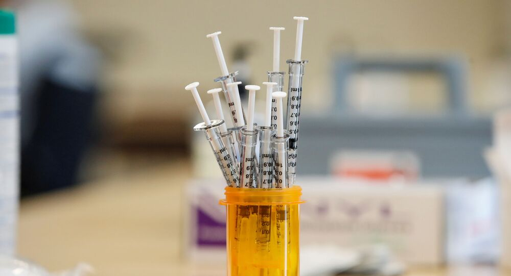 Syringes with the Pfizer-BioNTec  vaccine against coronavirus disease (COVID-19) sit on the table at the Victor Walchirk Apartments in Evanston, Illinois, U.S. February 22, 2021