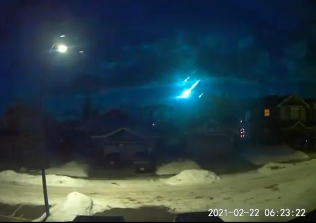 Screenshot from a video showing a fireball lighting up the sky above Royal Oak, Alberta, Calgary