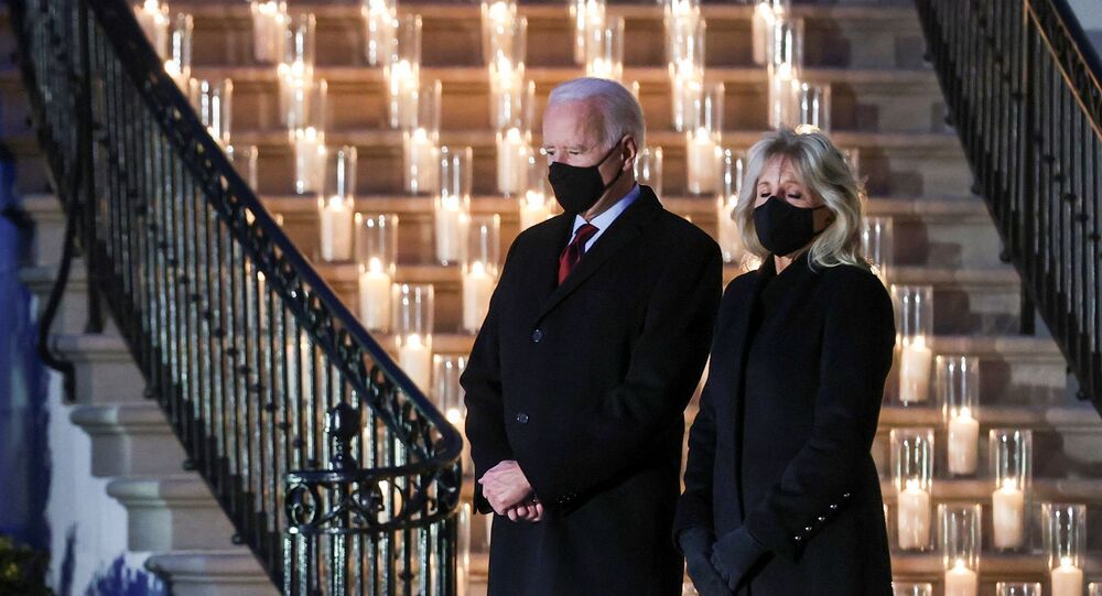 U.S. President Joe Biden and his wife Jill Biden attend a moment of silence and candle lighting ceremony to commemorate the grim milestone of 500,000 U.S. deaths from the coronavirus disease (COVID-19) at the White House in Washington, U.S., February 22, 2021.